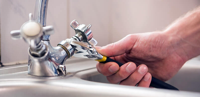 Hand Fixing A Tap