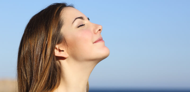 Woman Practising Deep Breathing