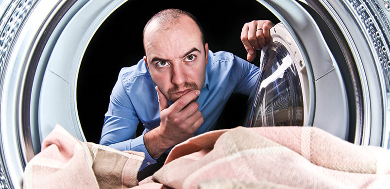 Man Looking Inside Washing Machine