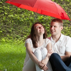 Couple Having Picnic With Umbrella