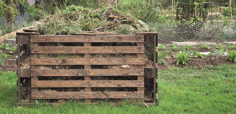 Wooden Compost Heap In Garden