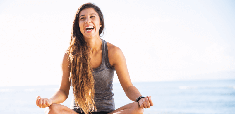 Woman Meditating And Laughing