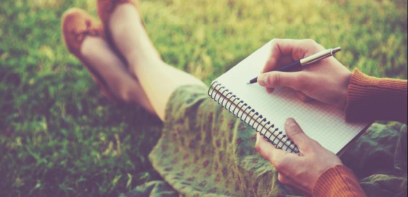 Woman Writing In New Diary