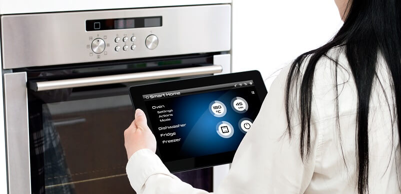 Woman Controlling Appliances With Tablet