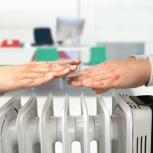 Hands Over Electrical Radiator