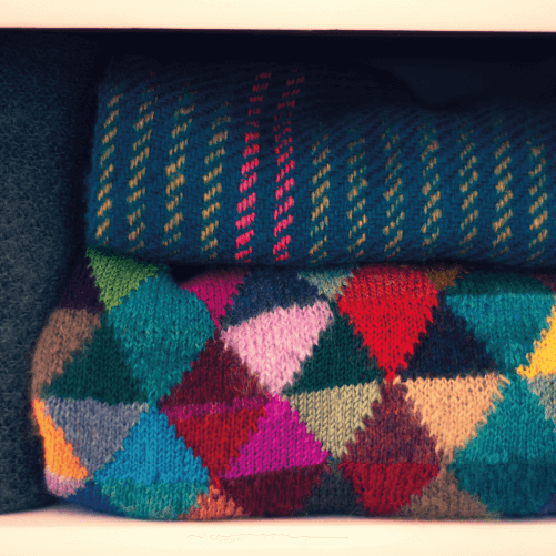 Pile Of Colourful Jumpers