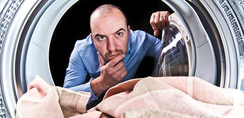 Man Looking Inside Dryer