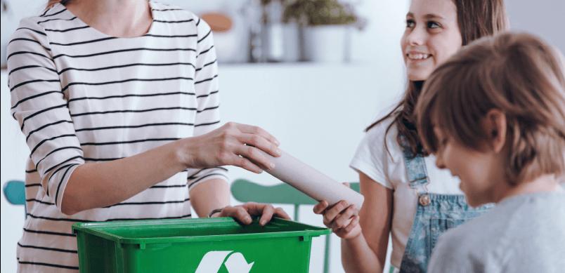 Woman Teaching Child Recycling