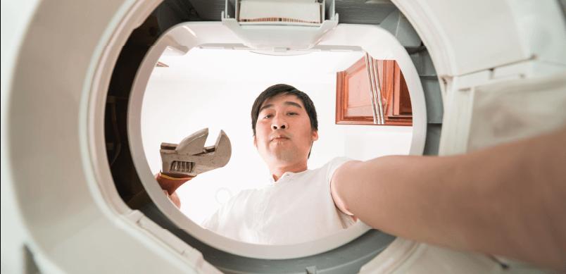 Man Fixing Washing Machine