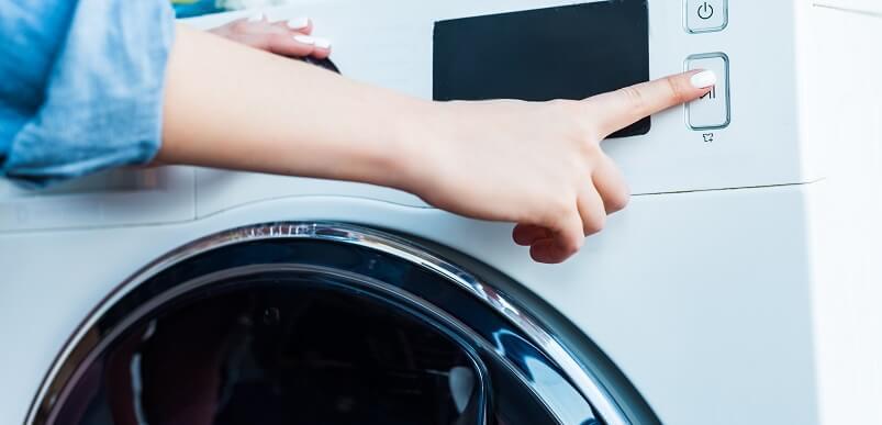 Person Turning Washing Machine On