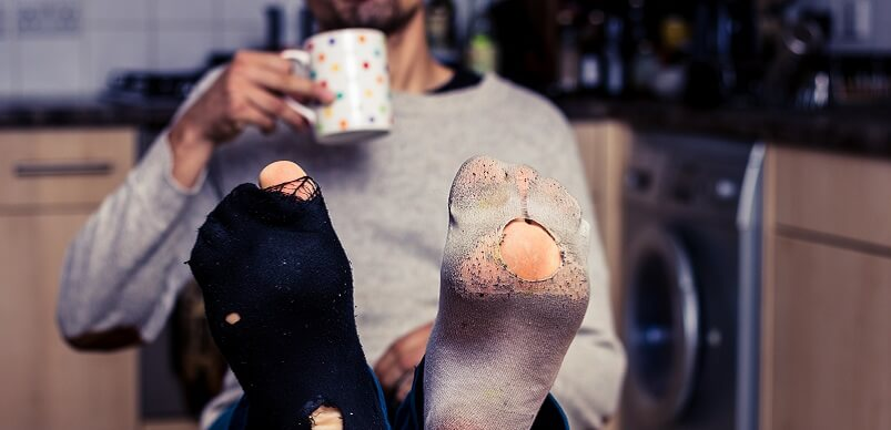 Man Wearing Socks With Holes