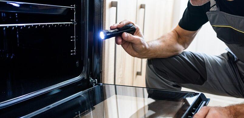 Man looking Inside Oven