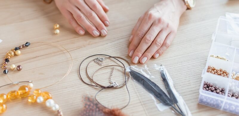 Person Making Jewellery