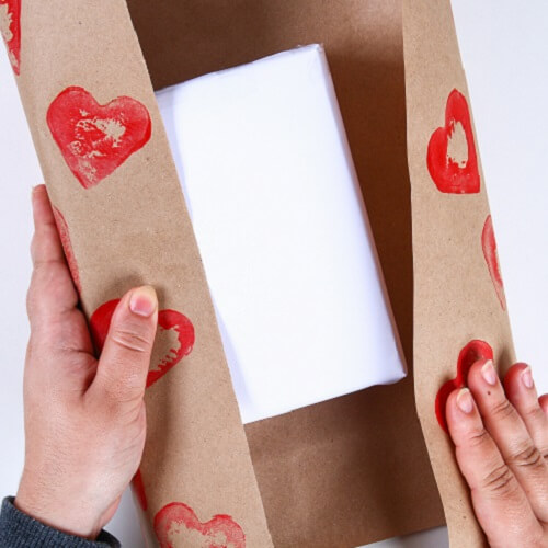 Gift Wrapped With Sustainable Paper With Hearts