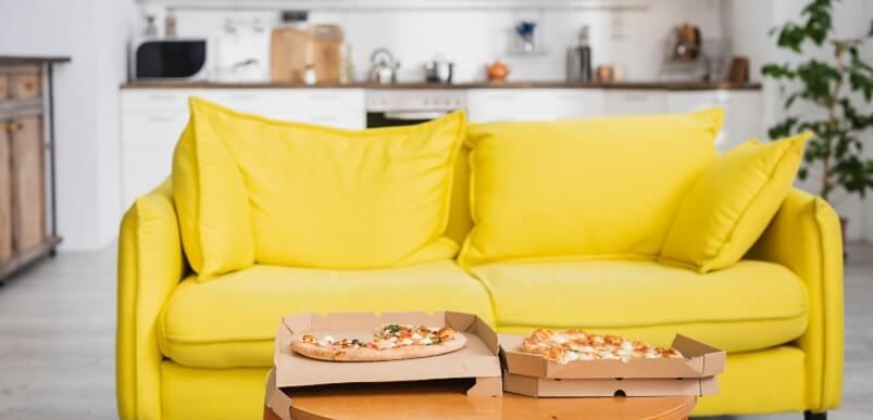 Pizza Next to Yellow Sofa