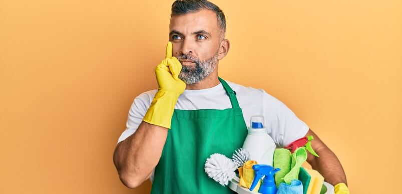 Man Thinking Holding Cleaning Equipment