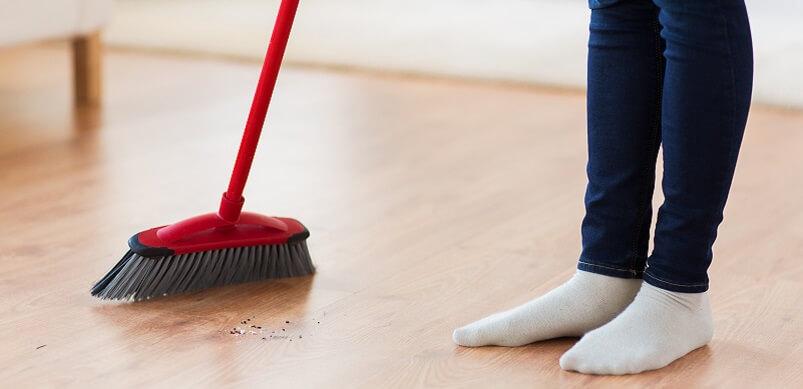 Woman Sweeping Wooden Flooring