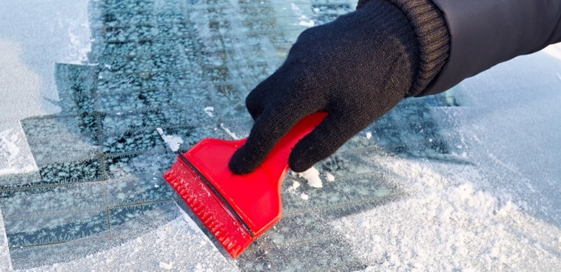 Person Scraping Ice From Car