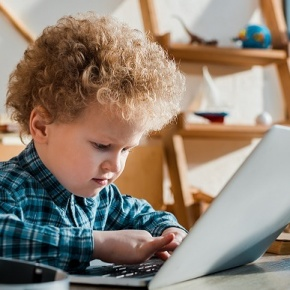 Child On Laptop At Home