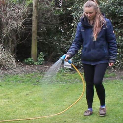 Amy Watering Lawn With Rolson Spray Gun