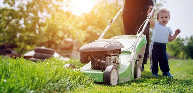Child Next To Lawnmower