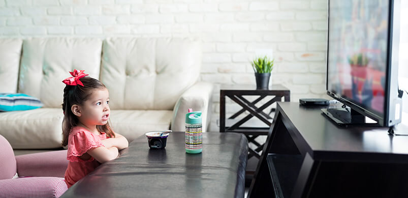 Child Watching TV In Living Room