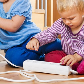 Children Playing With Plugs
