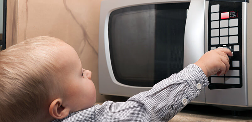 Child Reaching For Microwave