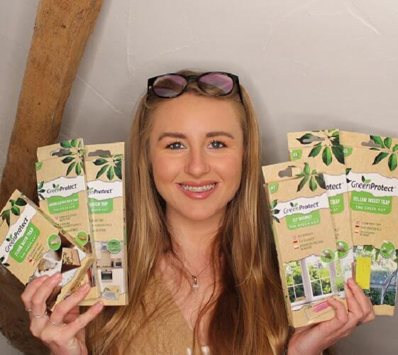 Amy Holding Green Protect Products