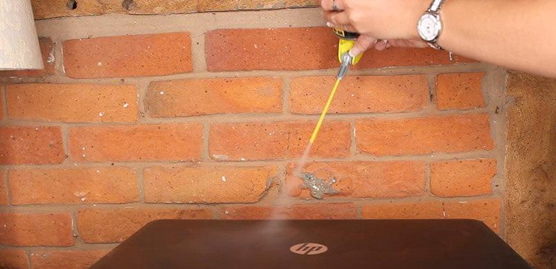 Spraying WD-40 On Laptop