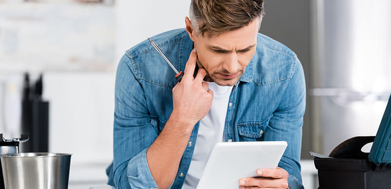 Man Reading Fixing Instructions