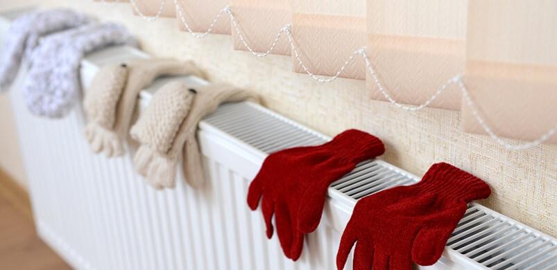 Gloves Drying on Heating Radiator