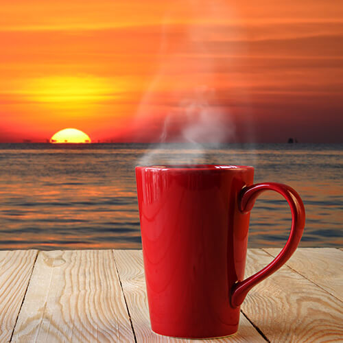 Sunrise And Coffee Cup