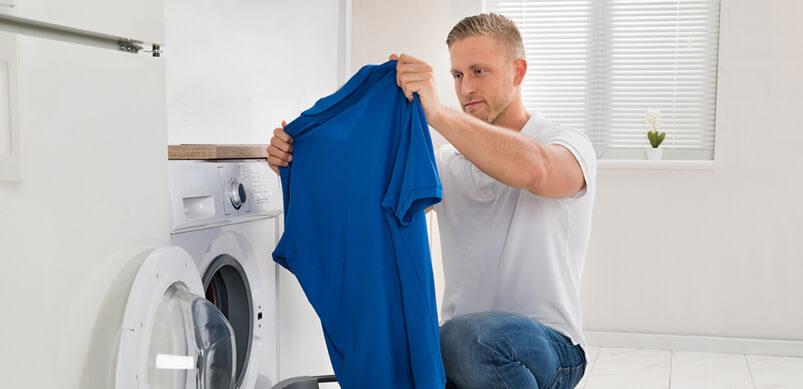 Man Holding Shirt