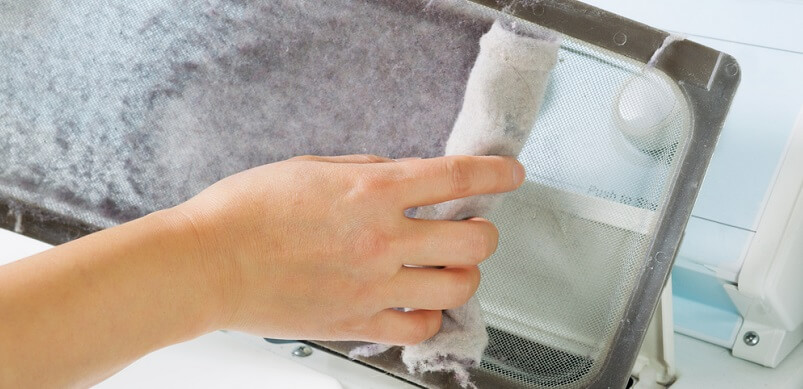Tumble Dryer Filter Getting Cleaned