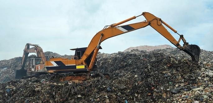 Digger In Landfill Site